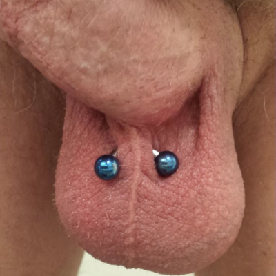 Lorum piercing with curved bar and large balls and some extra room on the bar suitable for healing