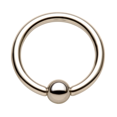 "A captive bead ring in 3/4"" diameter or large is a common initial jewelry option for the lorum piercing"