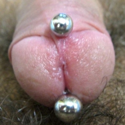 A shallow Prince Albert with a curved bar, placed too close to the urethra, on an intact (uncircumcised) build